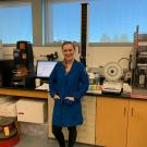Jackie poses in lab after being given the Outstanding Graduate Student award